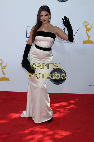 Mayra Veronica.The 64th Annual Primetime Emmy Awards - Arrivals, held at Nokia Theatre L.A. Live in Los Angeles, California, USA..September 23rd, 2012.emmys full length black white strapless dress clutch bag gloves hand arm waving belt.CAP/ADM/RE.©Russ Elliot/AdMedia/Capital Pictures.