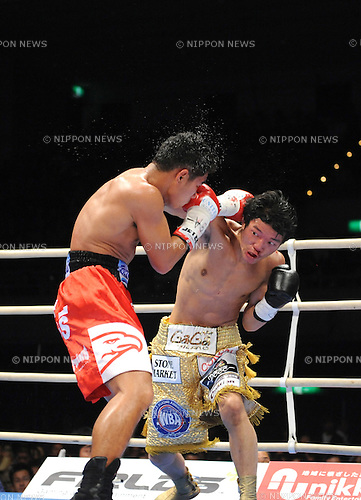 (L-R) Tepparith Kokietgym (THA), Daiki Kameda (JPN), DECEMBER 7, 2011 - Boxing : Daiki Kameda of Japan and Tepparith Kokietgym of Thailand in action during the WBA super flyweight title bout at Osaka Prefectural Gymnasium in Osaka, Osaka, Japan. (Photo by Mikio Nakai/AFLO)