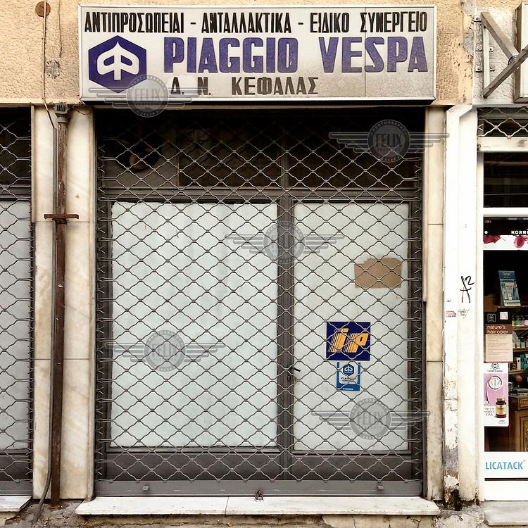 A shop that sells parts for Piaggio Vespa motorscooters on Filippou Street.