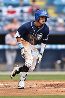 Asheville Tourists center fielder Manny Melendez (19) runs to first base during a game against the Greenville Drive at McCormick Field on April 16, 2017 in Asheville, North Carolina. The Drive defeated the Tourists 4-2. (Tony Farlow/Four Seam Images)