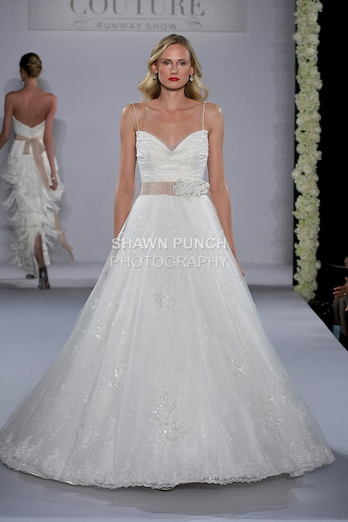 Model walks runway in a Jayla wedding dress from the Maggie Sottero Spring 2013 Bridal collection, for the Couture Runway Show, during New York Bridal Fashion Week at The Hilton Hotel, October 13, 2012.