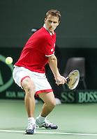 04-03-2006,Swiss,Freibourgh, Davis Cup , Swiss-Netherlands,  Marco Chiudinelli in action against Sjeng Schalken