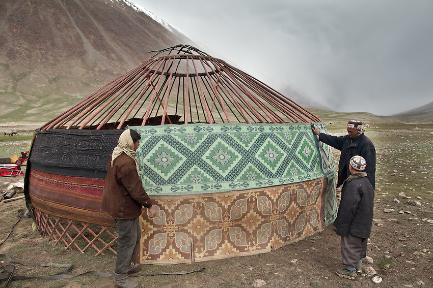 Setting up the yurt of the Khan, the tribal leader, during yearly summer migration. Afghan Kyrgyz are semi-nomadic people...Trekking through the high altitude plateau of the Little Pamir mountains (average 4200 meters) , where the Afghan Kyrgyz community live all year, on the borders of China, Tajikistan and Pakistan.