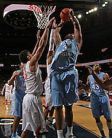 North Carolina forward Kennedy Meeks (3) shoots next to Virginia forward Anthony Gill (13) during an NCAA basketball game against Virginia Monday Jan. 20, 2014 in Charlottesville, VA. Virginia defeated North Carolina 76-61.