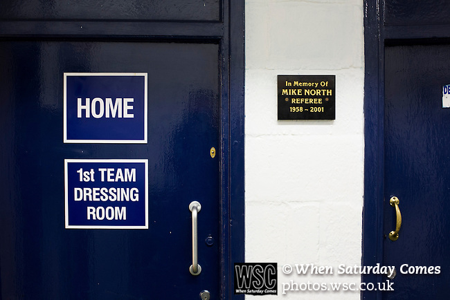 Southend United 1 Burton Albion 1, 22/02/2016. Roots Hall, League One. The home dressing room door next to a plaque dedicated to former referee Mike North under the main stand at Roots Hall stadium, pictured before Southend United took on Burton Albion in a League 1 fixture. Founded in 1906, Southend United moved into their current ground in 1955, the construction of which was funded by the club's supporters. Southend won this match by 3-1, watched by a crowd of 6503. Photo by Colin McPherson.