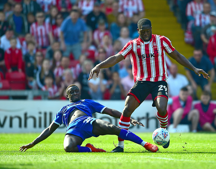 Lincoln City's John Akinde battles with Tranmere Rovers' Zoumana Bakayogo<br /> <br /> Photographer Andrew Vaughan/CameraSport<br /> <br /> The EFL Sky Bet League Two - Lincoln City v Tranmere Rovers - Monday 22nd April 2019 - Sincil Bank - Lincoln<br /> <br /> World Copyright © 2019 CameraSport. All rights reserved. 43 Linden Ave. Countesthorpe. Leicester. England. LE8 5PG - Tel: +44 (0) 116 277 4147 - admin@camerasport.com - www.camerasport.com