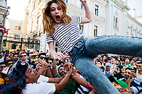 Moscow, Russia, 16/06/2018.<br /> Mexico supporters throw young Russian women in the air in central Moscow during the 2018 FIFA World Cup.