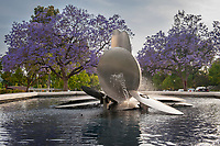Occidental College entrance, Alumni Drive and Campus Road, looking east towards George Baker's Lucille Y. Gilman Memorial Fountain. Purple blooming jacaranda trees can also be seen. June 10, 2010 (Photo by Marc Campos, Occidental College Photographer)