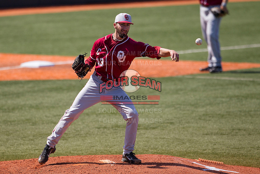 Oklahoma Sooners starting pitcher Dillon Overton #13 makes a pickoff throw to first base against the Texas Longhorns in the NCAA baseball game on April 6, 2013 at UFCU DischFalk Field in Austin, Texas. The Longhorns defeated the rival Sooners 1-0. (Andrew Woolley/Four Seam Images).