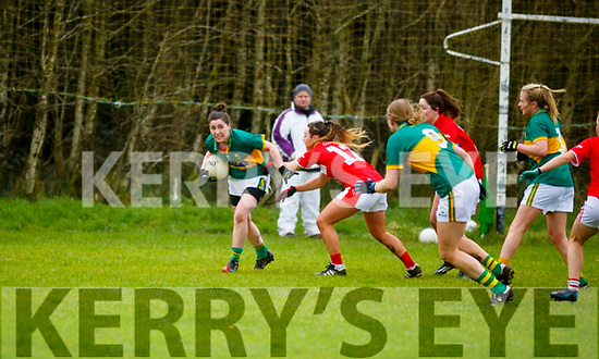 Kate O'Sullivan of Kerry trying the clear the ball, under pressure against Cork in the opening round of the Lidl NFL Division1 on Sunday last in Knocknagoshel.