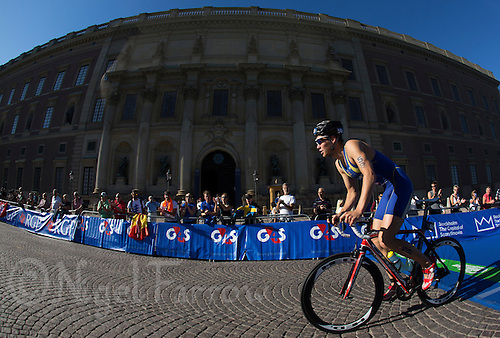 25 AUG 2013 - STOCKHOLM, SWE - Joel Vikner (SWE) of Sweden passes the royal palace during the bike at the men's ITU 2013 World Triathlon Series round in Gamla Stan, Stockholm, Sweden (PHOTO COPYRIGHT © 2013 NIGEL FARROW, ALL RIGHTS RESERVED)