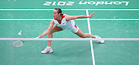 28 JUL 2012 - LONDON, GBR - Susan Egelstaff (GBR) of Great Britain returns during her London 2012 Olympic Games women's singles group badminton match against Maja Tvrdy (SLO) of Slovenia at Wembley Arena, London, Great Britain .(PHOTO (C) 2012 NIGEL FARROW)