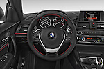 Car pictures of steering wheel view of a 2017 BMW 2-Series 230i 2 Door Coupe Steering Wheel