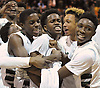 Elmont teammates celebrate after their 41-32 win over Harborfields in the Class A varsity boys basketball Long Island Championship at LIU Post on Sunday, Mar. 6, 2016.