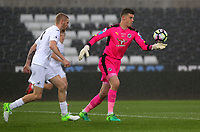 Pictured: George Legg of Reading (R) takes a kick Monday 15 May 2017<br />