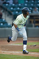Seuly Matias (25) of the Wilmington Blue Rocks hustles down the first base line against the Winston-Salem Dash at BB&T Ballpark on April 15, 2019 in Winston-Salem, North Carolina. The Dash defeated the Blue Rocks 9-8. (Brian Westerholt/Four Seam Images)