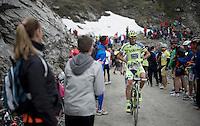 Roman Kreuziger (CZE/Tinkoff-Saxo) stuffing a gazette under his jersey (against the cold down the descent) up the dirt roads of the Colle delle Finestre (2178m)<br /> <br /> Giro d'Italia 2015<br /> stage 20: Saint Vincent - Sestriere (199km)
