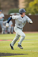 Jackson Raper (14) of the Catawba Indians hustles down the first base line against the Belmont Abbey Crusaders at Abbey Yard on February 7, 2017 in Belmont, North Carolina.  The Crusaders defeated the Indians 12-9.  (Brian Westerholt/Four Seam Images)