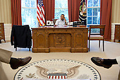 United States President Barack Obama talks on the phone with President Nicolas Sarkozy of France in the Oval Office, Saturday, July 23, 2011. .Mandatory Credit: Pete Souza - White House via CNP