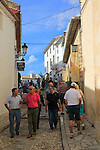 Tourists in streets of hilltop castle and village, El Castell de Guadalest, Alicante province, Spain