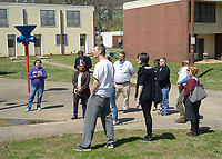 NWA Democrat-Gazette/ANDY SHUPE<br /> Deniece Smiley (center), Fayetteville Housing Authority director, leads a tour Friday, March 30, 2018, of Lewis Plaza, a property that the authority directs, for the organization's board of directors and members of the public in Fayetteville. The board this year has to come up with a capital improvements plan, per U.S. Department of Housing and Urban Development regulations.