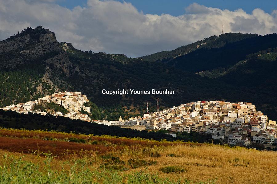 Beautiful, chiaroscuro dappled light bathing the village of Moulay Idriss Zerhoun the founding village of modern Morocco