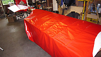 BNPS.co.uk (01202 558833)<br /> Pic: PhilYeomans/BNPS<br /> <br /> Taking shape - the wings are covered in 'Ricthofen red' fabric.<br /> <br /> Dreaded Red Baron to fly again...WW1 Ace's feared 'Fokker Dreidecker' to finally fly over Britain.<br /> <br /> A German GP based in Norfolk has spent 8 years building a Fokker triplane in his garage as a tribute to infamous WW1 Ace Manfred von Ricthofen, who terrorised the skies over the Western front during the first war.<br /> <br /> Dr Peter Brueggemann, 52, will fulfil his childhood dream and emulate the notorious German fighter pilot when the Dreidecker Dr.1 fighter finally achieves lift-off this summer.<br /> <br /> Dr Brueggemann has even acquired the title Baron from the independent territory of Sealand so he can take to the skies as Baron Peter von Brueggemann in homage to his idol.<br /> <br /> The GP at the Holt Medical Practice in Norfolk hopes to be airborne in a few months once tests on the engine are completed at Felthorpe airfield near Norwich where he has devoted thousands of hours to the project.<br /> <br /> The father-of-two, who has lived in England with wife Sue for 20 years, has been taking flying lessons since his project began.