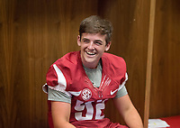 Hawgs Illustrated /BEN GOFF @NWABENGOFF<br /> Blake Mazza, a freshman kicker from Plano, Texas, hangs out in the locker room Saturday, Aug. 5, 2017, during Arkansas football media day at the Fred W. Smith Football Center in Fayetteville.