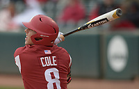 NWA Democrat-Gazette/ANDY SHUPE<br />Arkansas right fielder Eric Cole follows through against South Carolina Saturday, April 14, 2018, during the second inning at Baum Stadium. Visit nwadg.com/photos to see more photographs from the game.