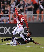 DC United defender Lawson Vaughn (15) slides to makes a pass against Chivas USA defender Yamith Cuesta (45).  Chivas USA defeated DC United 2-0  at RFK Stadium, Saturday October 3, 2009.