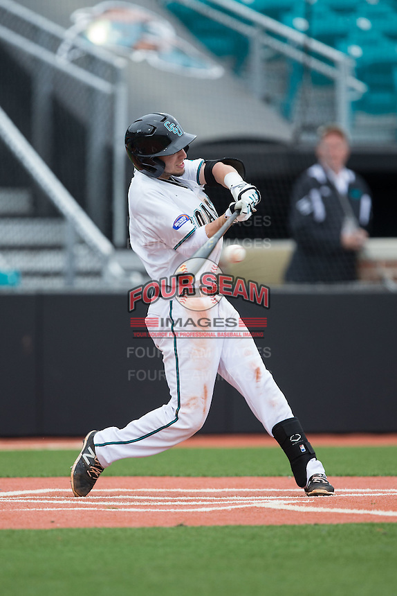 Michael Paez (1) of the Coastal Carolina Chanticleers makes contact with the baseball against the Bryant Bulldogs at Springs Brooks Stadium on March 13, 2015 in Charlotte, North Carolina.  The Chanticleers defeated the Bulldogs 7-2.  (Brian Westerholt/Four Seam Images)