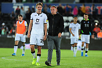 George Byers of Swansea City and Steve Cooper Head Coach of Swansea City applauds the fans at the final whistle during the Carabao Cup First Round match between Swansea City and Northampton Town at the Liberty Stadium in Swansea, Wales, UK. Tuesday 13 August 2019