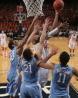 Virginia forward Akil Mitchell (25) is covered up by North Carolina forward Brice Johnson (11), North Carolina forward Jackson Simmons (21) and North Carolina forward James Michael McAdoo (43) during the second half of an NCAA basketball game Monday Jan. 20, 2014 in Charlottesville, VA. Virginia defeated North Carolina 76-61. (Photo/Andrew Shurtleff)