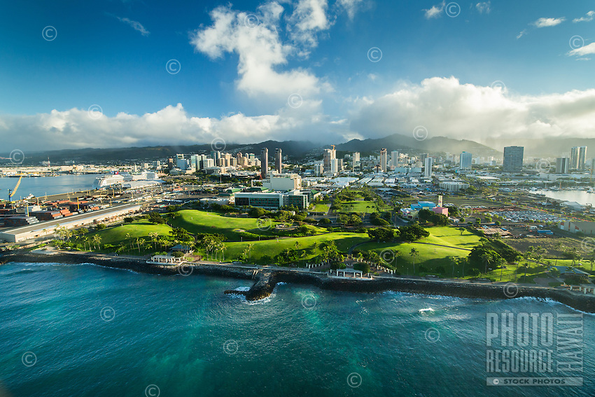 """Kaka'ako Waterfront Park (or """"Point Panic Park""""), with downtown Honolulu in the distance, O'ahu."""