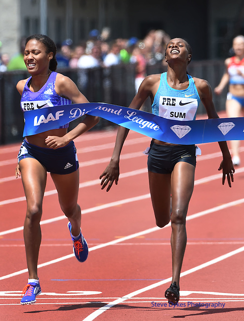 Eunice Jepkoech Sum of Kenya (R) crosses the finish line ahead of Ajee Wilson of the USA (L) to win the Women's 800 meters on the final day of the Prefontaine Classic at Hayward Field in Eugene, Oregon, USA, 30 MAY 2015. (EPA photo by Steve Dykes)