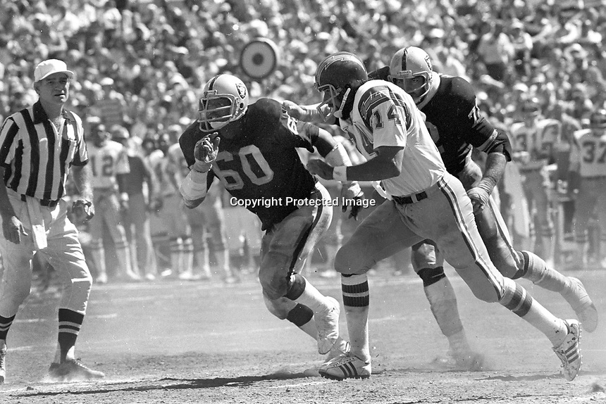 San Diego Charger QB Dan Fouts is chased by Oakland Raiders Otis Sistrunk and John Matuszak. (1976 photo/Ron Riesterer)