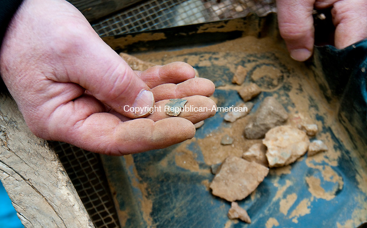 WATERBURY, CT--042315JS02- Lou Bianchi, Primary Investigator with the RBA Group in New Jersey, show some items they found as his team looks for Indian artifacts at a site on the southern leg of the Waterbury Greenway Project on Thursday. <br /> Jim Shannon Republican-American