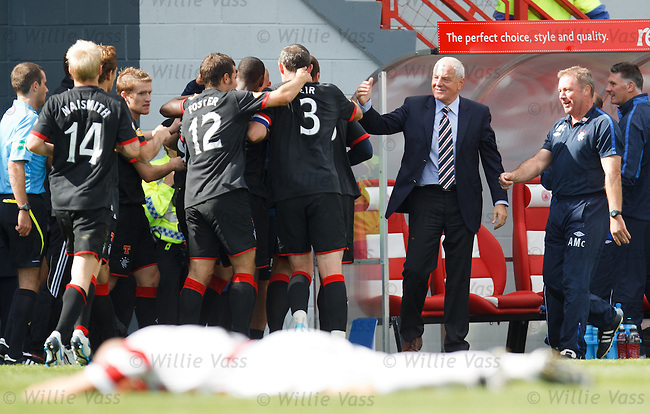 Walter Smith leaps out of the dugout to celebrate as Kenny Miller scores the winner