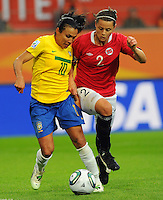 Marta (l) of team Brazil and Nora Holstad Berge of team Norway during the FIFA Women's World Cup at the FIFA Stadium in Wolfsburg, Germany on July 3rd, 2011.