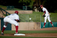 STANFORD, CA - April 21, 2011: Mark Appel of Stanford baseball looks to first base during Stanford's game against UCLA at Sunken Diamond. Stanford won 7-4.