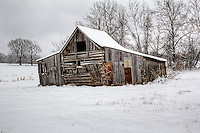 An old barn covered with snow during a snowstorm in rural Northwest Arkansas.