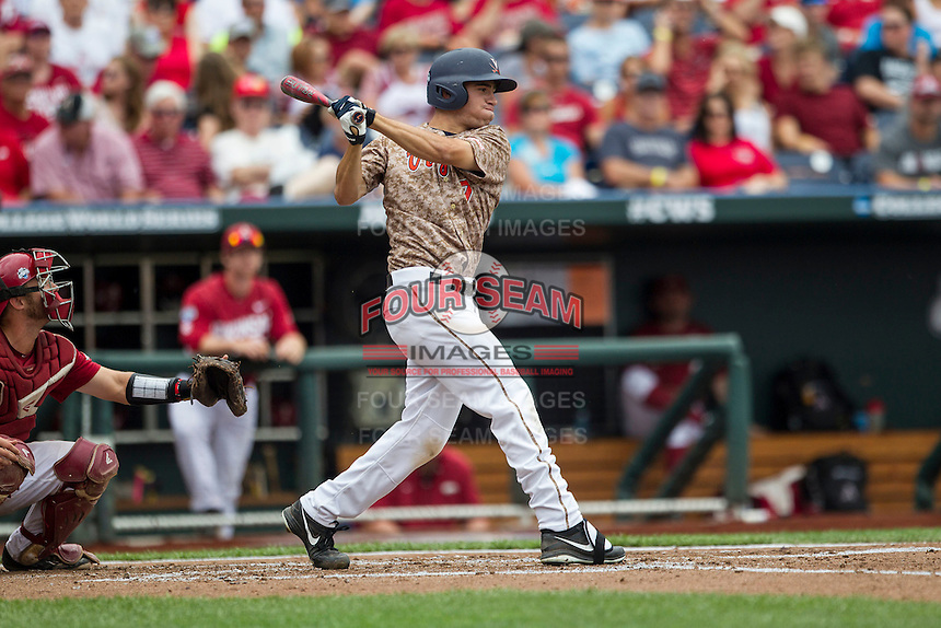 Virginia Cavaliers outfielder Adam Haseley (7) follows through on his swing against the Arkansas Razorbacks in Game 1 of the NCAA College World Series on June 13, 2015 at TD Ameritrade Park in Omaha, Nebraska. Virginia defeated Arkansas 5-3. (Andrew Woolley/Four Seam Images)