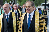 Lord Mance and other Justices of The Supreme Court walk to Westminster Abbey for a service to mark the inauguration of the new Supreme Court.