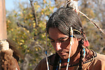 A Native American Indian man holding a spear