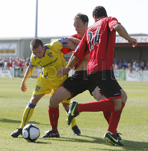 22nd August 2009. Barrow's David Foley battles for the ball in the Eastbourne penalty area against Marc Pullan (centre) and Gary Elphick (24) during the second half. Blue Square Premier league match - Eastbourne Borough v AFC Barrow Town at Eastbourne, Sussex, England..Photo: Colin Read/ActionPlus.
