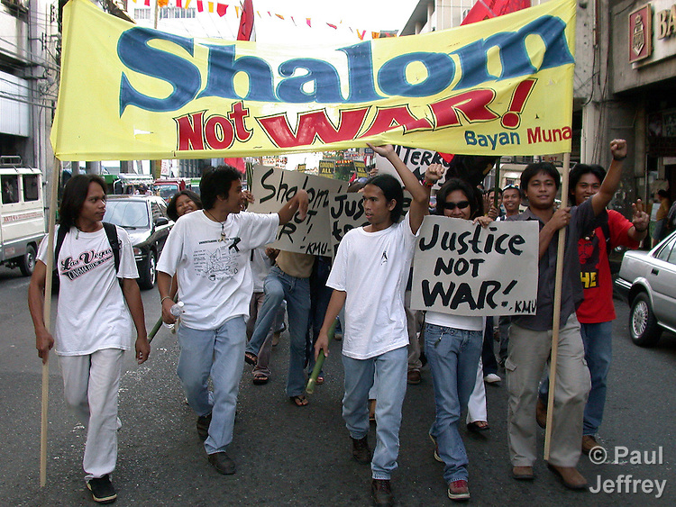 Participants in a March 12, 2003, interreligious peace march in Davao, in the war-torn southern Philippines region of Mindanao....