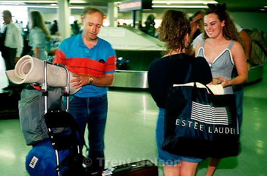 Steve Nelson at the airport picking up Christina and Tiffany Truman after a semester at LDS Business College. The backpack is her 72 hour kit. February 1991.  &amp;#xA;<br />