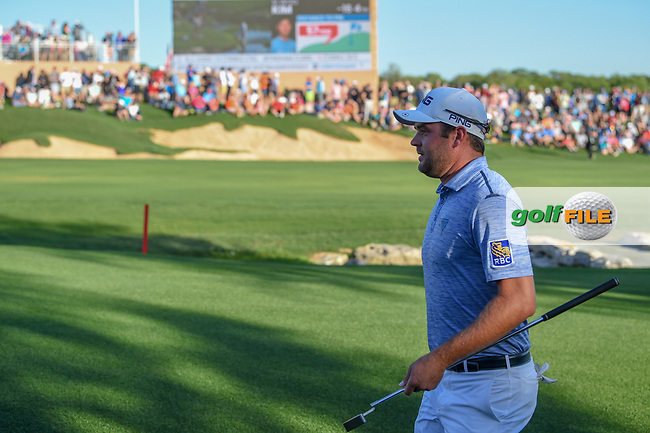 Corey Conners (CAN) makes his way to the green on 18 during day 4 of the Valero Texas Open, at the TPC San Antonio Oaks Course, San Antonio, Texas, USA. 4/7/2019.<br /> Picture: Golffile | Ken Murray<br /> <br /> <br /> All photo usage must carry mandatory copyright credit (© Golffile | Ken Murray)