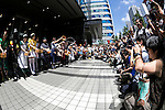 Maid cafe waitresses and cosplayers sprinkle water during the ''Uchimizukko Big Gathering Festival'' in Akihabara electric district of Tokyo, Japan on August 23, 2015. About 21 groups from Akihabara including maid cafes' waitresses and cosplayers attended the event, which included for the first time an official mascot character ''2C Chan.'' This year is the 12th anniversary of the event which began as a way to reduce dust and cool pavements in the Akihabara area. Uchimizukko is a Japanese summer tradition. (Photo by Rodrigo Reyes Marin/AFLO)