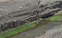 Airstream trailer alone banks of Rio Grande River, Taos County, New Mexico. June 2014